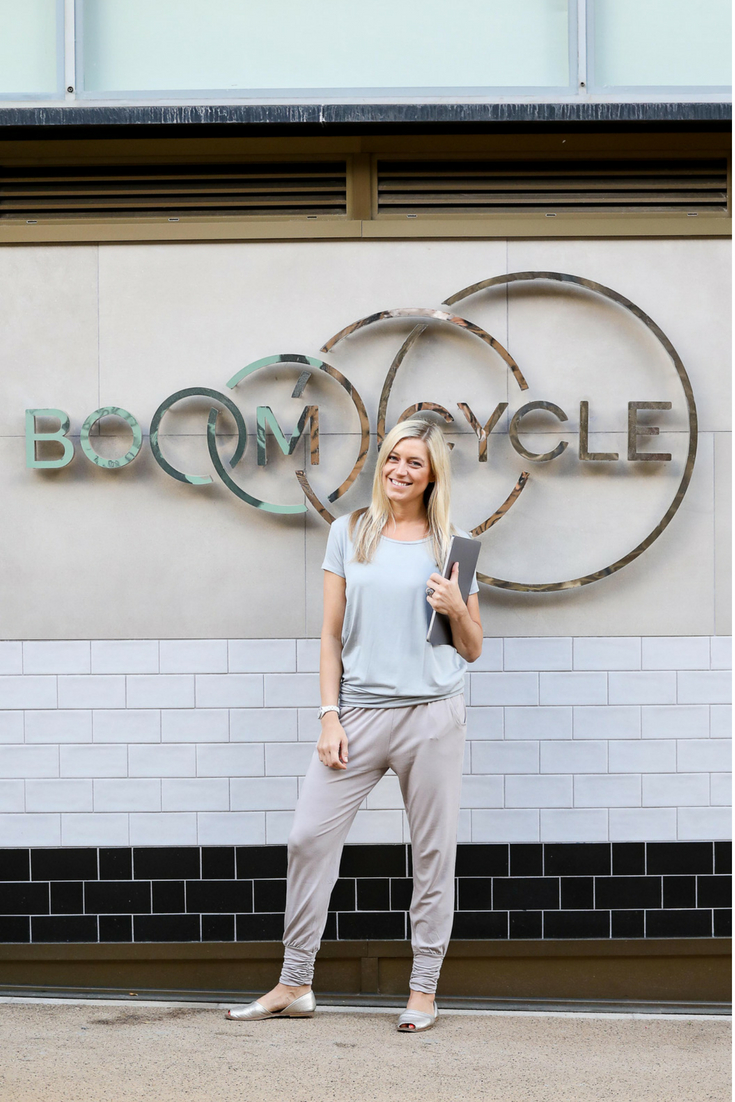Hilary Rowland outside Boom Cycle in Asquith activewear
