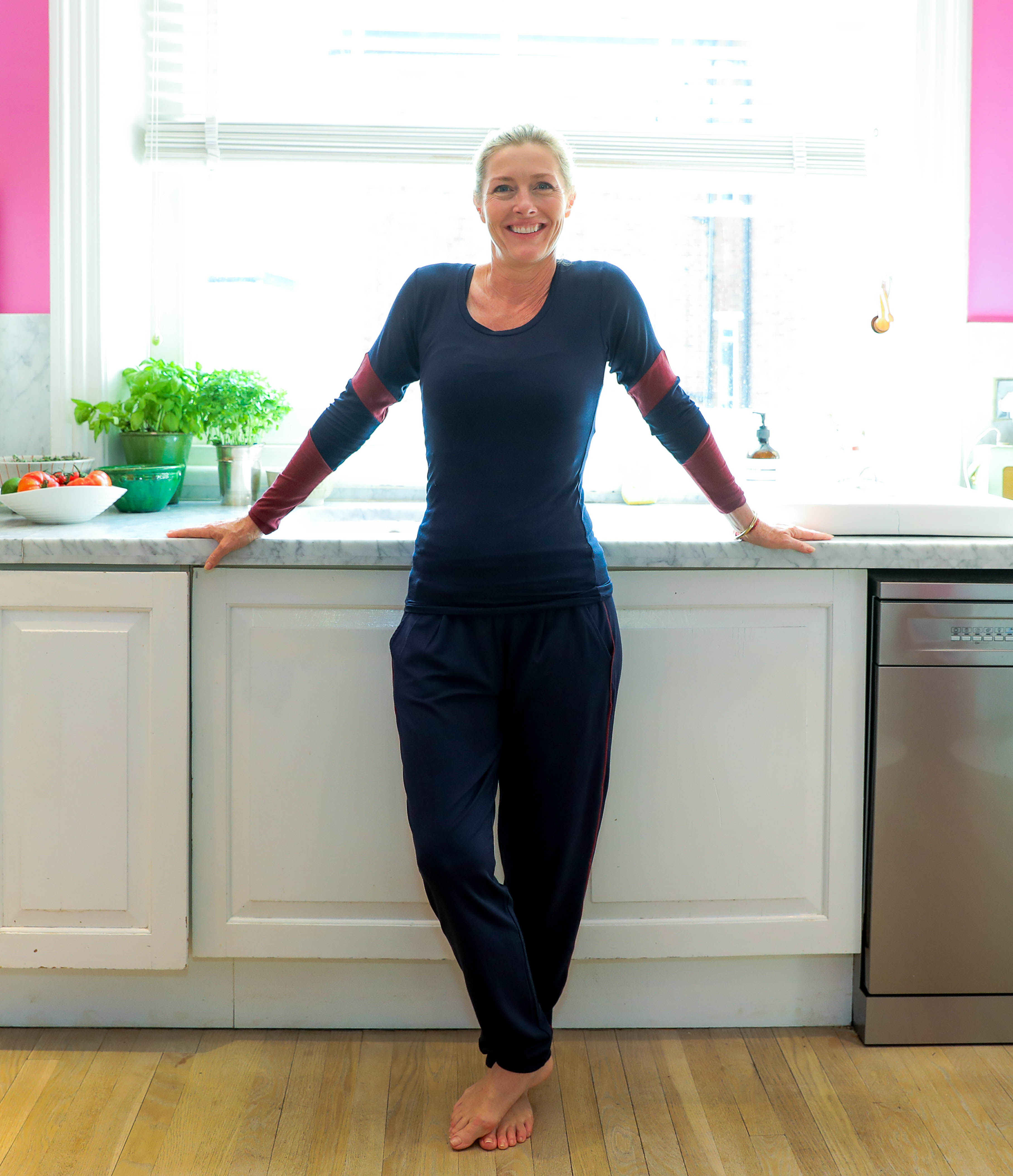 Sophie Conran wears Asquith bamboo Pilates pants and bamboo yoga top in her pink kitchen.